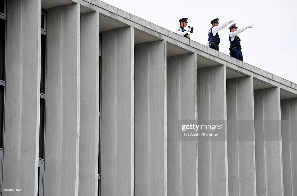 Police officers patrol on the roof top of the Hiroshima Peace Museum in preparation for the visit by U.S. President Barack Obama on May 26, 2016 in Hiroshima, Japan. Obama becomes the first sitting U.S. president to visit Hiroshima, where the first atomic bomb was dropped in 1945 at the end of World War II.