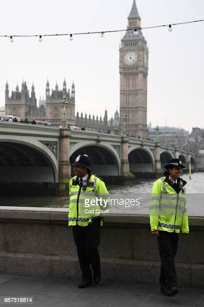Police officers patrol on the South Bank on March 24 2017 in London England A fourth person has died after Khalid Masood drove a car into pedestrians...