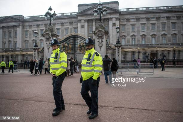 Police officers patrol outside Buckingham Palace on March 24 2017 in London England A fourth person has died after Khalid Masood drove a car into...