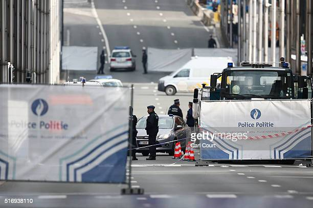 Police officers patrol outside Maelbeek metro station following todays attack on March 22 2016 in Brussels Belgium At least 31 people are thought to...