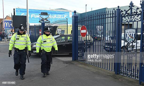 Police officers patrol outside the stadium ahead of the English Premier League football match between West Bromwich Albion and Arsenal at The...