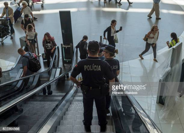 Police officers patrol Terminal 1 of the Humberto Delgado International Airport on July 25 2017 in Lisbon Portugal The Portuguese tourist industry is...