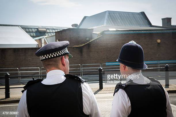 Police officers patrol the area around West London Coroners' Court on July 1 2015 in London England Victims of last Friday's terrorist attack in...