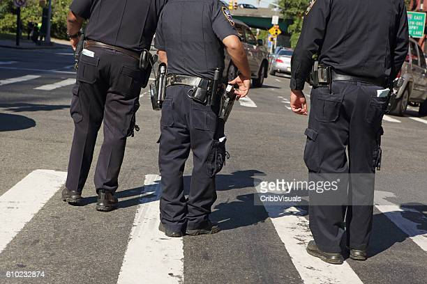 NYPD police officers patrol the Atlantic Antic street fair Brooklyn