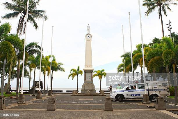 Police officers patrol the Cairns esplanade ensuring tourists vacate the area in preparation for Cyclone Yasi on February 2 2011 in Cairns Australia...