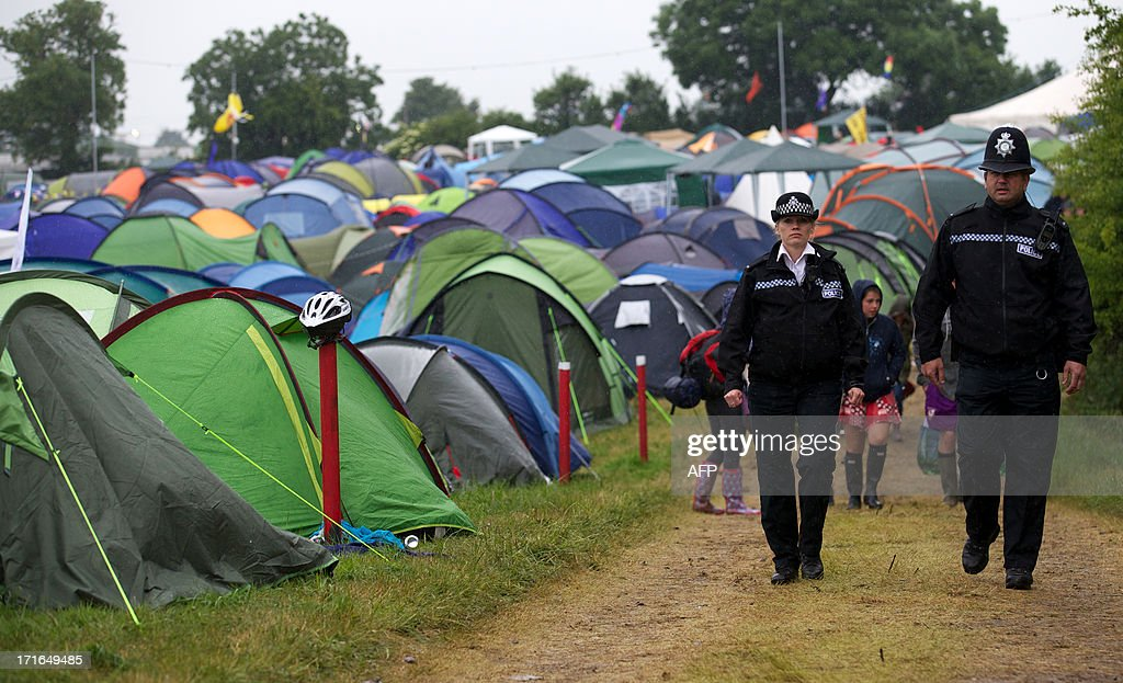 Police officers patrol the campsite on the second day of the Glastonbury Festival of Contemporary Performing Arts near Glastonbury, southwest England, on June 27, 2013. The festival attracts 170,000 party-goers to the dairy farm in Somerset, and this year's tickets sold out within two hours of going on sale. The Rolling Stones will perform at the festival for the first time, headlining on Saturday night. AFP PHOTO/ANDREW COWIE