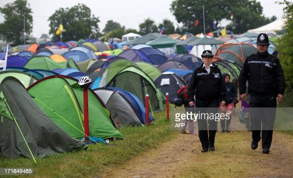 Police officers patrol the campsite on the second day of the Glastonbury Festival of Contemporary Performing Arts near Glastonbury southwest England...