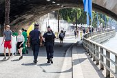 Police officers patrol the docks of the Seine in order to ensure the safety of 'Paris Plage' during the opening day on July 20 2016 in Paris France...