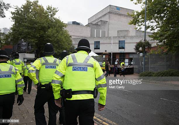 Police officers patrol the exterior of the ICC Birmingham which is hosting the 2016 Conservative Party Conference on October 1 2016 in Birmingham...