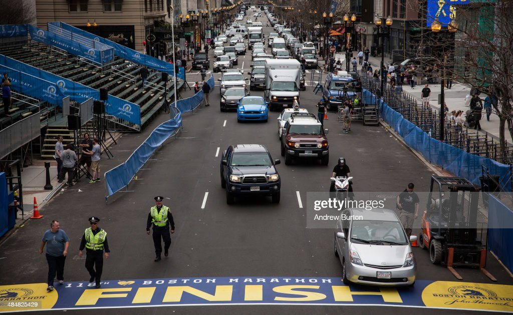 Police officers patrol the finish line of the Boston Marathon, on April 14, 2014 in Boston, Massachusetts. Last year, two pressure cooker bombs killed three and injured an estimated 264 others during the Boston marathon, on April 15, 2013.