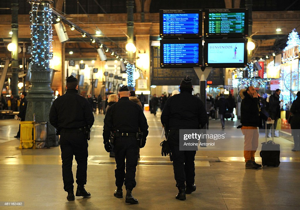 Police officers patrol the Gare du Nord railway station on January 8 2015 in Paris France France's Vigipirate terrorist security plan is at it's...