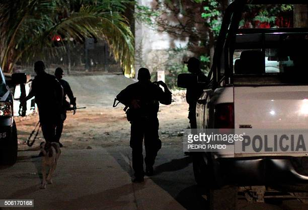 Police officers patrol the murder crime scene at Las Cruces neighbourhood in Acapulco Guerrero state Mexico on January 21 2016 Guerrero is one of...