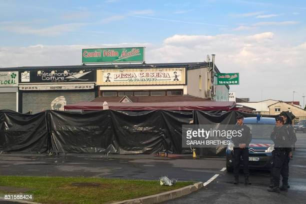TOPSHOT Police officers patrol the scene of a car crash into a pizza restaurant in SeptSorts 55km east of Paris on August 15 resulting in the death...