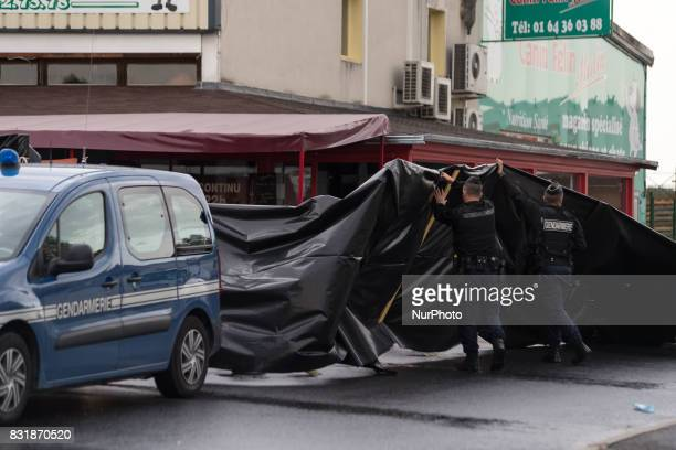 Police officers patrol the scene of a car crash into a pizza restaurant in SeptSorts 55km east of Paris on August 15 resulting in the death of a...