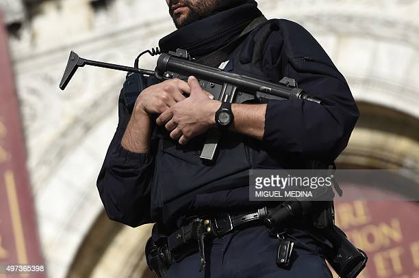 A police officers patrols in front of the Sacre Coeur Basilica on November 16 2015 in Paris three days after a series of deadly oordinated attacks...