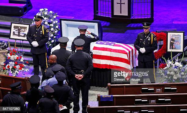 Police officers pay their respects at the funeral service for Senior Corporal Lorne Ahrens held at Prestonwood Baptist Church in Plano Texas Dallas...