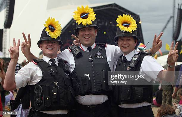 Police officers PC Sean Skelhorn PC Nick Hoon and Sgt Craig Osborne stand in front of the Pyramid Stage at the Glastonbury Festival at Worthy Farm...