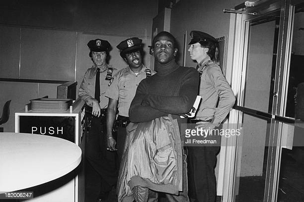 Police officers place their order at a counter in a fast food restaurant in Midtown Manhattan New York City 1980