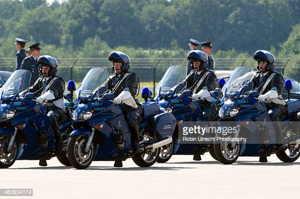 Police officers prepare to provide an escort for the remains of victims of Malaysia Airlines flight MH17 at Eindhoven Airport July 24 2014 in...