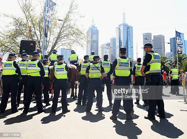 Police officers prepare to walk the parade route during the 2014 AFL Grand Final Parade on September 26 2014 in Melbourne Australia