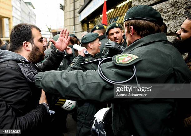 Police officers protect Salafi supporters against counter demonstrators at a public gathering on March 14 2015 in Wuppertal Germany Several hundred...