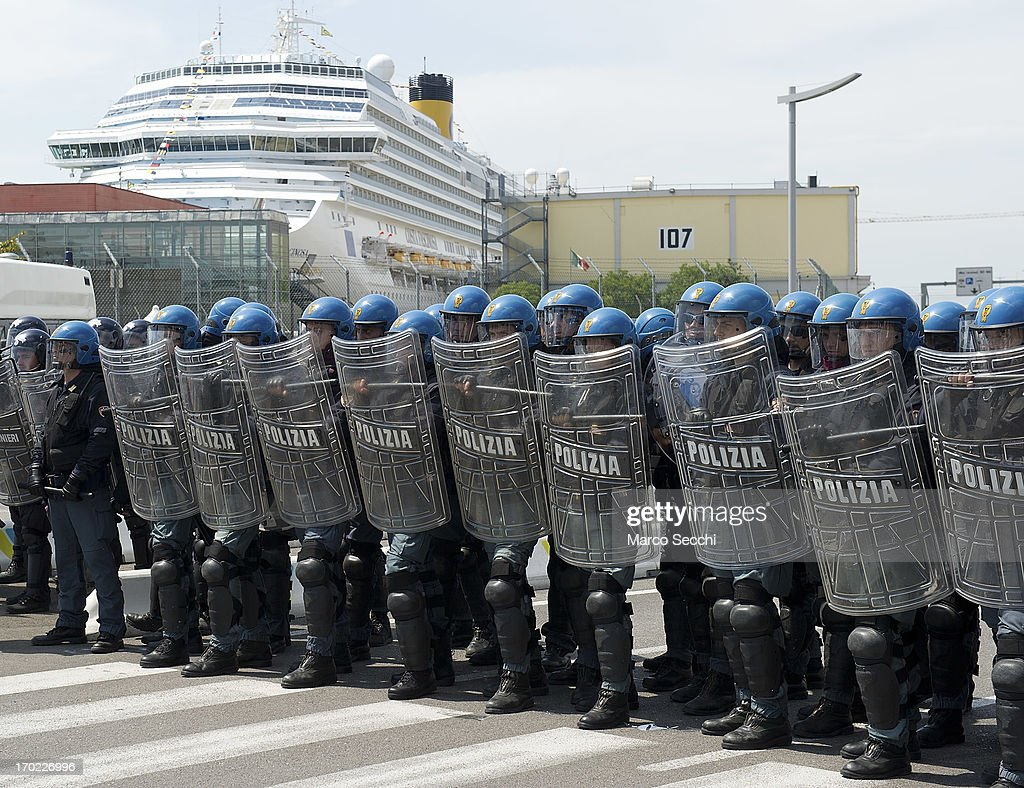 Police officers protect the access to the touristic port during the blockade of the Venice Tourist Port on June 9, 2013 in Venice, Italy. Three days of protests are being organised by Venetians and environmentalists, who are opposed to cruise ships crossing the St Mark's Basin.