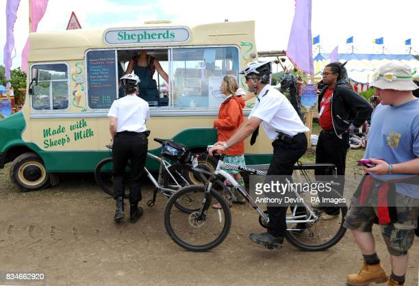 Police officers queue for ice cream during the 2008 Glastonbury Festival