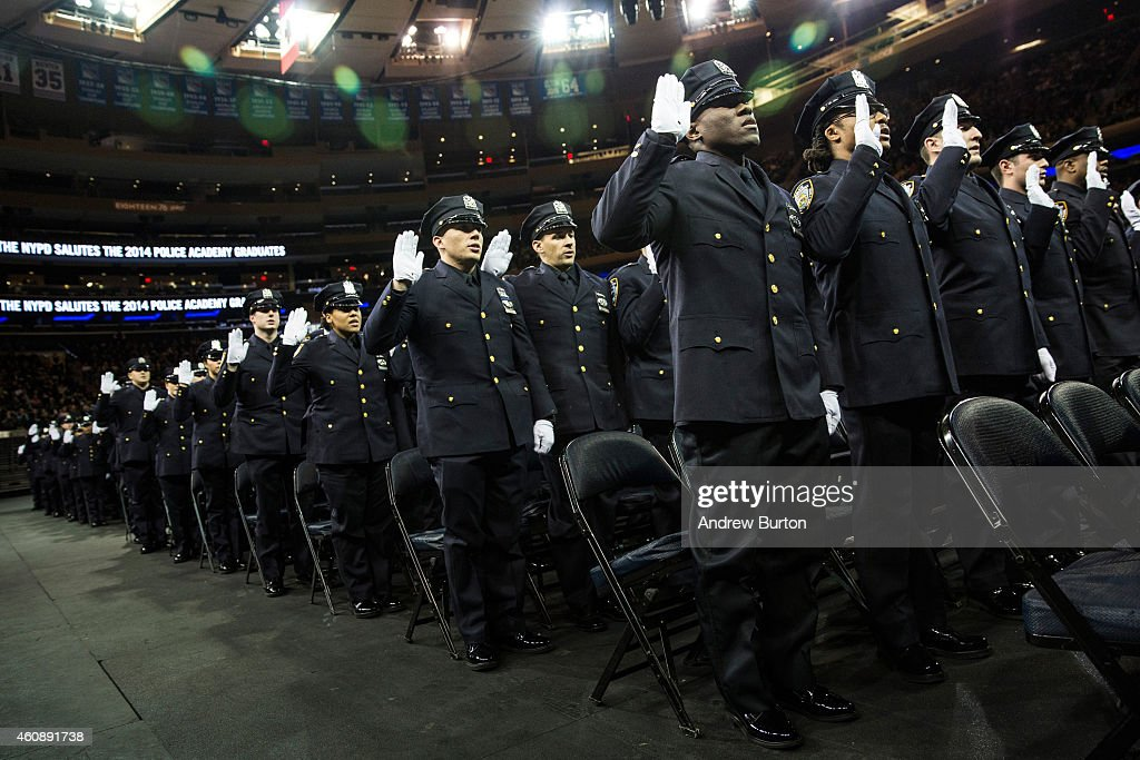 Police officers recite an oath during a new york police - Garden city police department ny ...