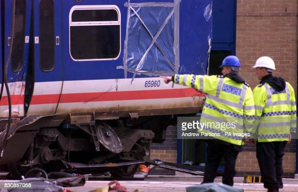 Police Officers' remove a carriage from where it was lying across two platforms at Potters Bar station north of London The lift was put on hold...