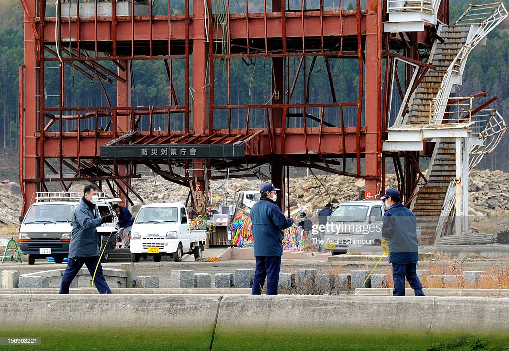Police officers remove the stand at the former Minamisanriku Disaster Prevention Center for the investigation on November 26, 2012 in Minamisanriku, Miyagi, Japan. The investigation is held as some of 42 victims and missings have accused the city mayor of professional negligence leading to death, claiming the evacuation guidance was inappropriate.