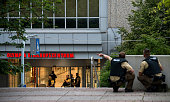Police officers respond to a shooting at the Olympia Einkaufzentrum at July 22 2016 in Munich Germany According to reports several people have been...