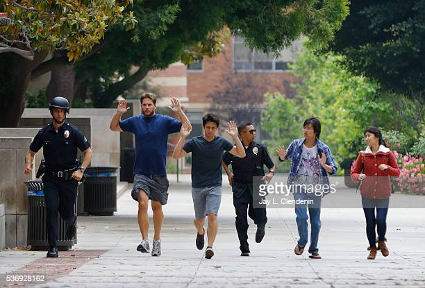 Police officers respond to reports of a shooting at UCLA on Wednesday morning prompting a massive response from local and federal law enforcement on...