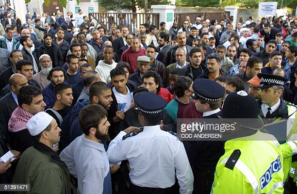 Police officers restrain a protestors outside London central mosque 02 November 2001 The group Muslims in the UK tried to rally support outside the...