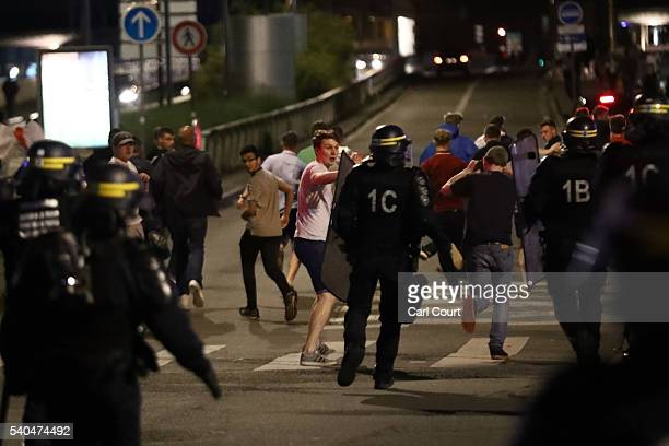 Police officers rush at England fans during clashes on June 16 2016 in Lille France Police used tear gas and pepper spray on the fans in a bid to...