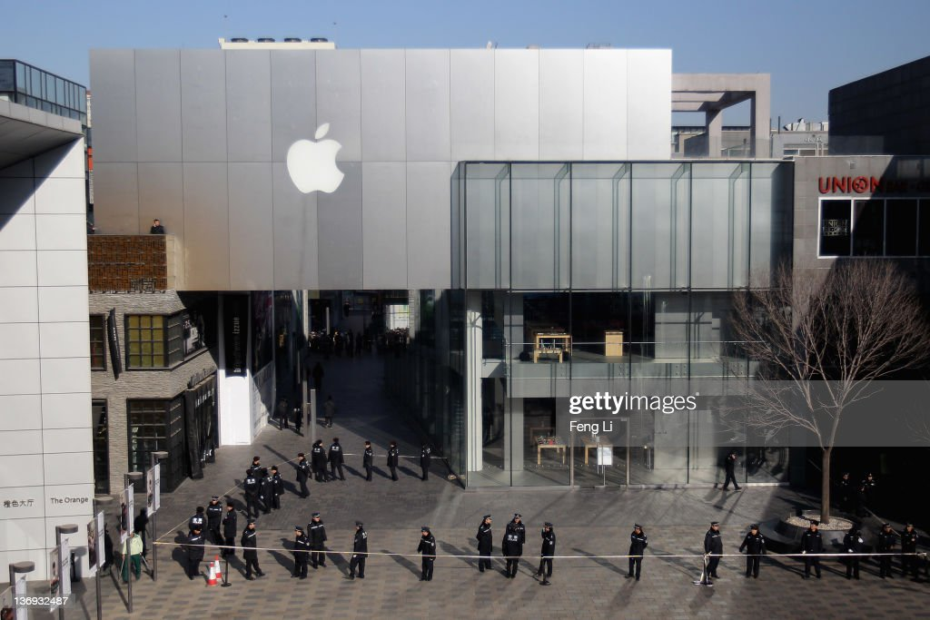 Police officers seal off the area near Apple's Beijing flagship store on January 13, 2012 in Beijing, China. Chinese angry crowd shouted and threw eggs outside Apple's Beijing flagship after it failed to open on schedule Friday to sell iPhone 4S.