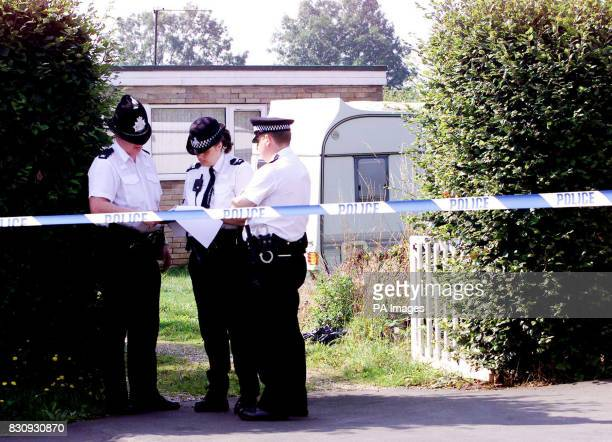 Police officers seal off the house of Kevin Huntley father of Ian Huntley on Parsons Lane Littleport Cambridgeshire Ian Huntley 28 and his girlfriend...