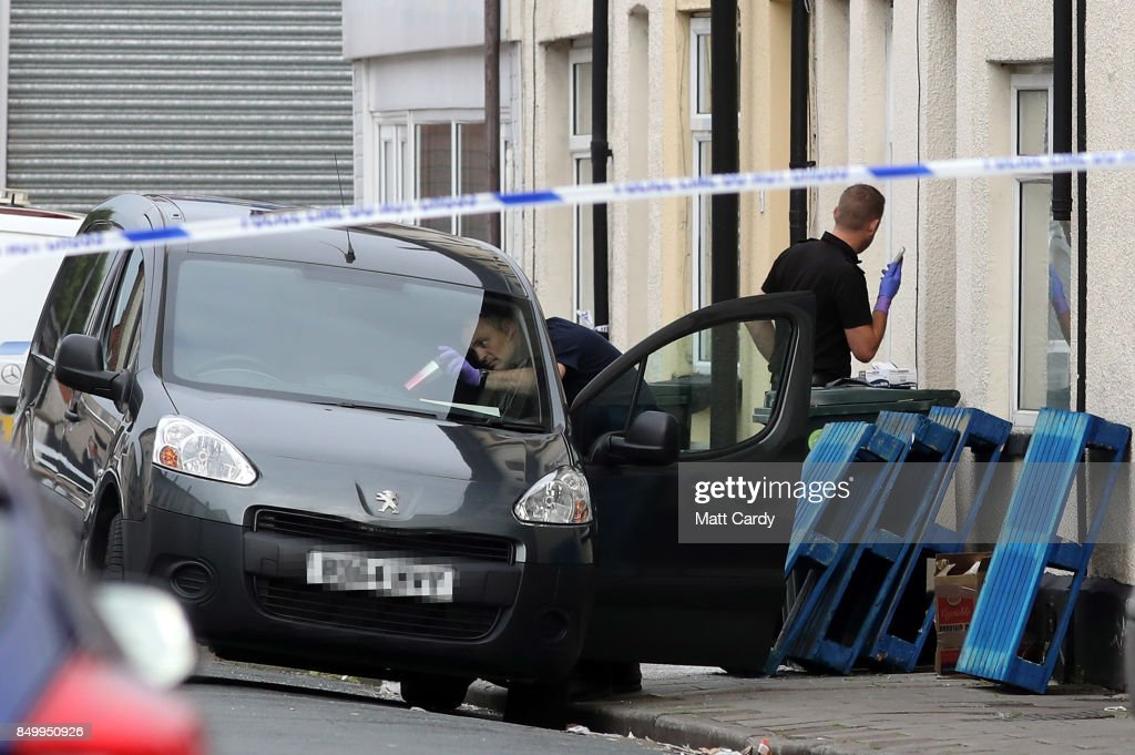 Police officers search a vehicle outside of a residential property on September 20, 2017 in Newport, Wales. A 48-year-old man and a 30-year-old man have been detained under the Terrorism Act after a search at an address in Newport. This morning's arrests bring the total number held to five.