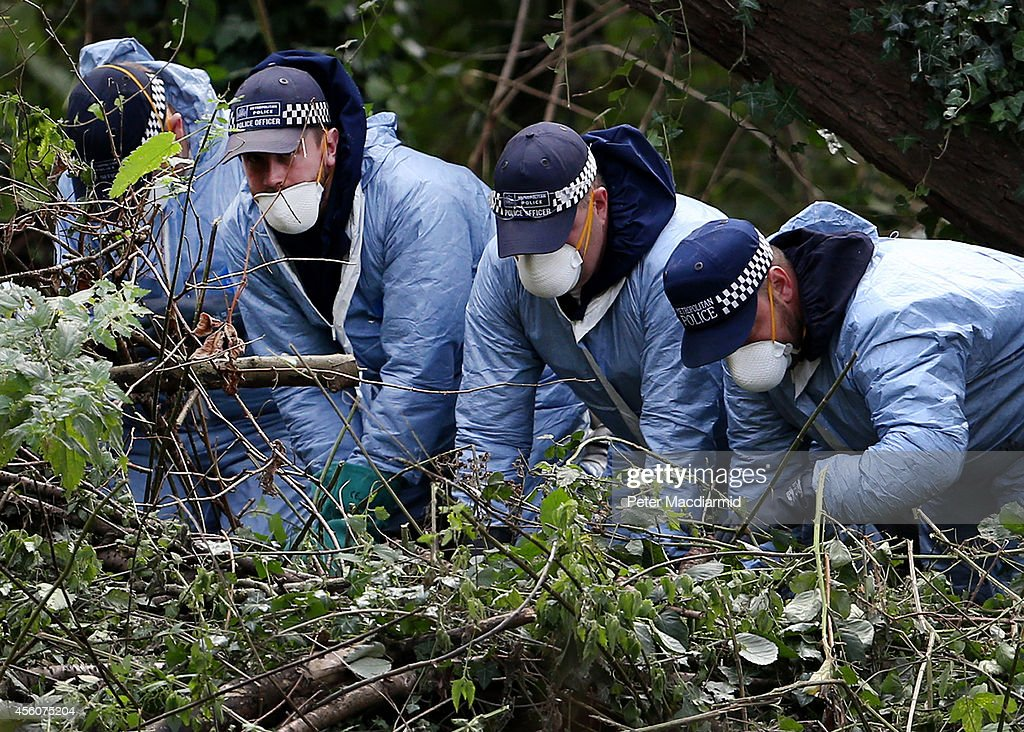 Police officers search an area next to the river Brent for clues in the hunt for schoolgirl Alice Gross on September 25, 2014 in London, England. The hunt for Alice Gross from Hanwell, who went missing on August 28, is now being described as the largest police search operation since the 7/7 bombings of 2005. The police inquiry is now focused on a key suspect, Arnis Zalkalns, a Latvian builder, who was seen in the vicinity of Alice's last sighting.