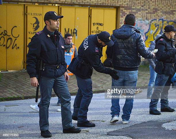 Police officers search fans before the match of Serie A between SSC Napoli and Internazionale Milan at the Stadio San Paolo November 30 2015 in...