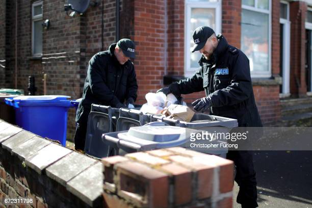 Police officers search for evidence near the scene in Cranbourne Rd ChorltoncumHardy where exRoyal Navy officer Michael Samwell was fatally injured...