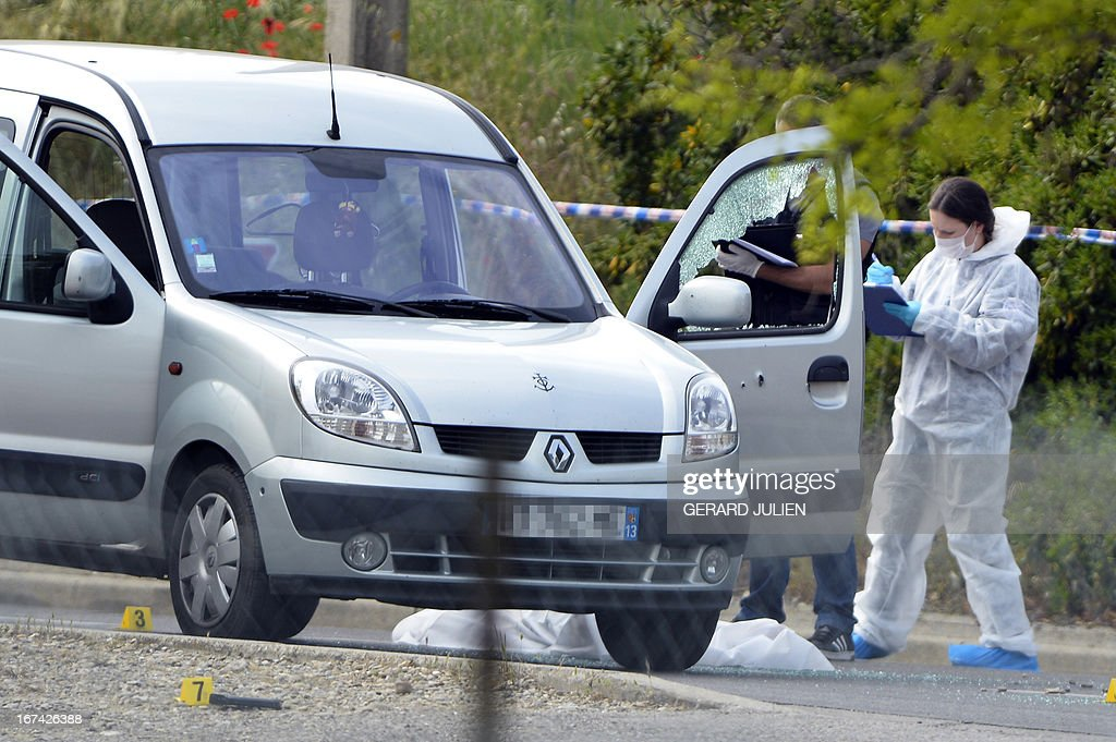 Police officers search for evidences at a crime scene where three persons have been killed and one injured during a shoutout on April 25, 2013 in Istres, near Marseille. A suspect has been arrested.