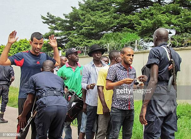 Police officers search residents of the southern districts of Brazzaville fleeing clashes between Congolese security forces and unknown assailants on...