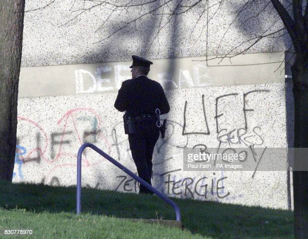 Police officers search the area of the shooting in the Forthriver road area of North Belfast where former police agent William Stobie an exUlster...
