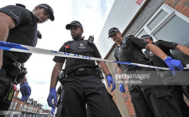 Police officers search the crime scene where Haroon Jahan and two other Asian men were hit by a car and killed in the early hours in Birmingham on...