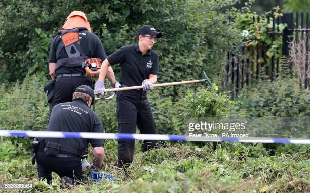 Police officers search the scene behind the Fir Tree pub in Croxteth Liverpool after 11yearold Rhys Jones was shot dead on Wednesday night