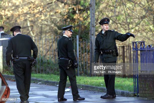 Police officers search the scene of the shooting in the Forthriver road area of North Belfast where former police agent William Stobie an exUlster...