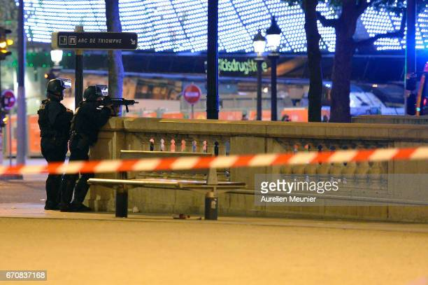 Police officers secure the area after a gunman opened fire on Champs Elysees on April 20 2017 in Paris France One police officer has been killed and...