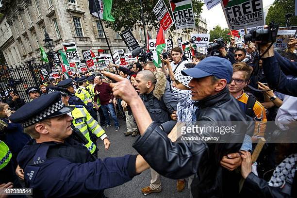 Police officers separate pro and antiIsrael demonstrators outside Downing Street in London England ahead of a visit by Israeli Prime Minister...