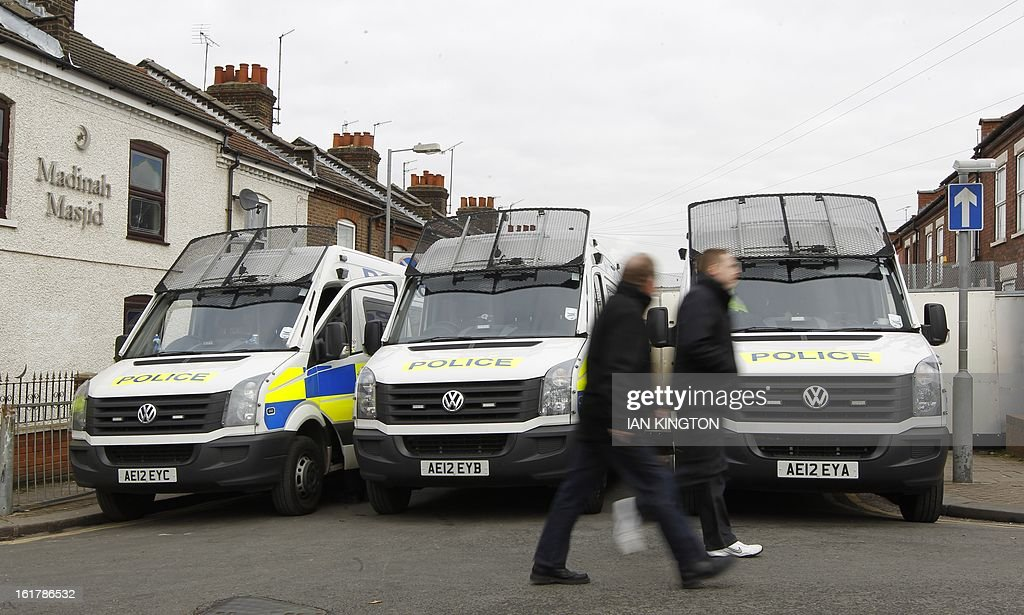 "Police officers set up a blockade on a street outside the ground before kick off in the English FA Cup fifth round football match between Luton Town and Millwall at Kenilworth Road Stadium, Luton, north of London on February 16, 2013. USE. No use with unauthorized audio, video, data, fixture lists, club/league logos or ""live"" services. Online in-match use limited to 45 images, no video emulation. No use in betting, games or single club/league/player publications."