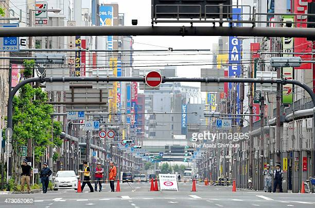 Police officers shut down the road led to the place where an unexploded bomb was found in the one of the entertainment area of Minami on May 9 2015...